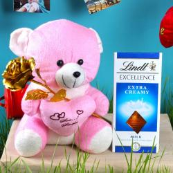 Golden Rose with Teddy Bear Holding a Heart and Lindt Chocolate