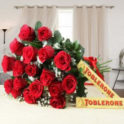 Valentine Gift of Eighteen Red Roses Bouquet with Toblerone Chocolates